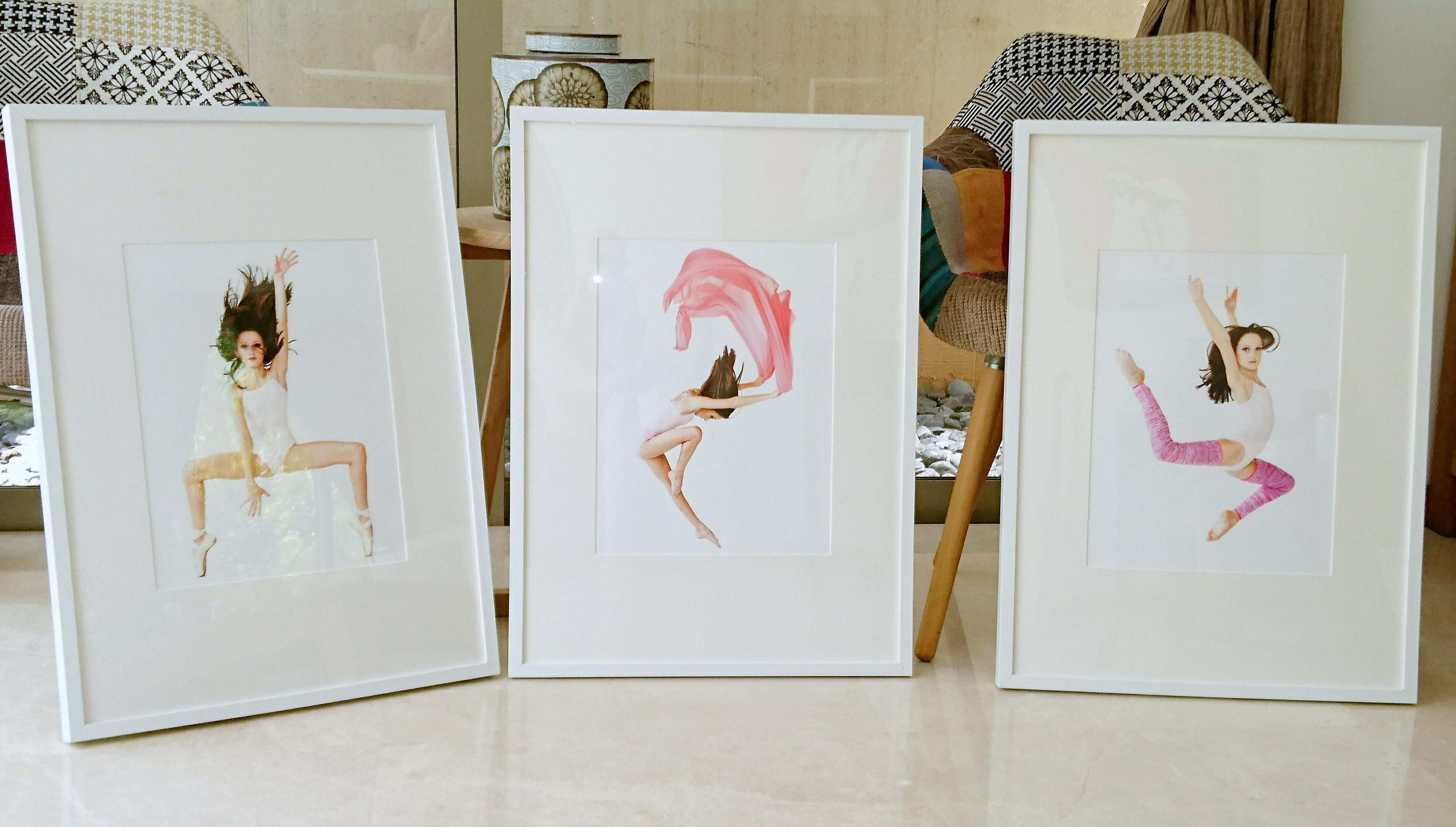three framed dance themed portraits