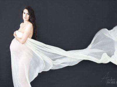 Plymouth MN pregnant mama poses with billowing white silk in maternity photo session
