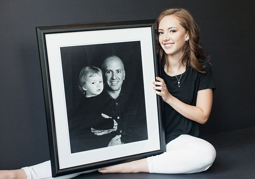 senior photo of girl with a portrait