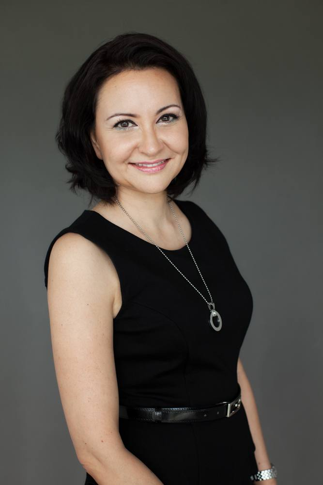 Professional corporate headshot of woman during photo session