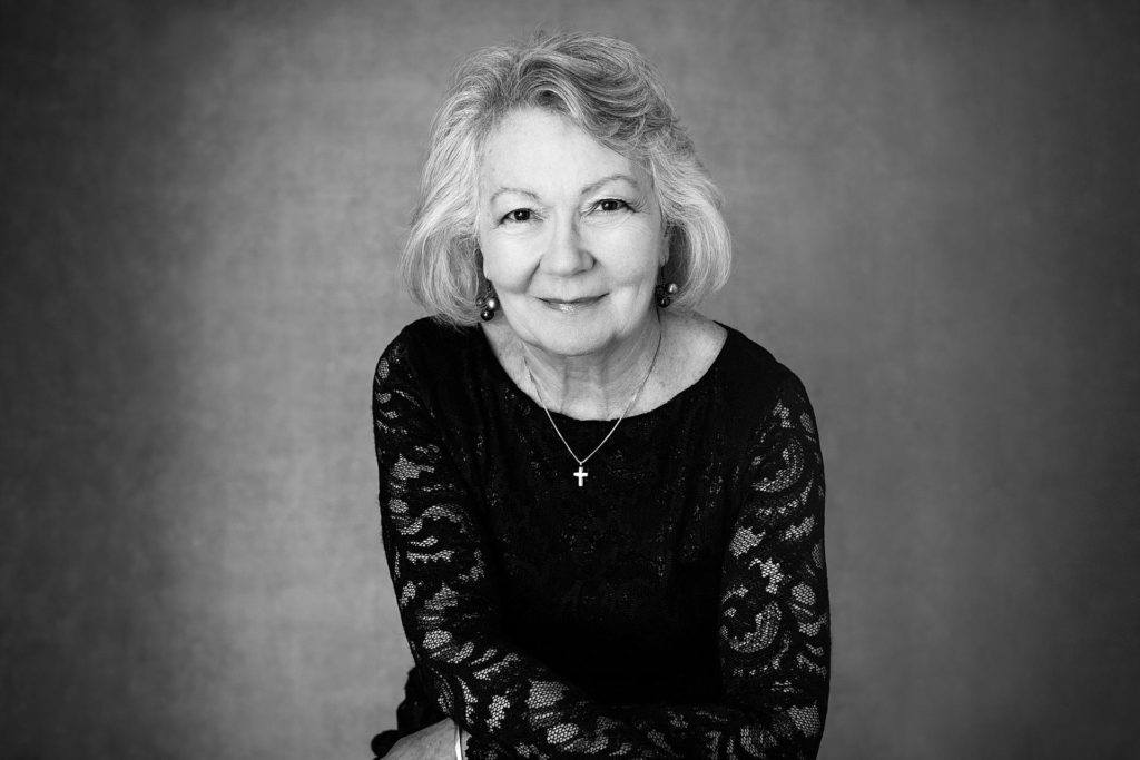 black and white portrait of mature woman in modern beauty photo shoot