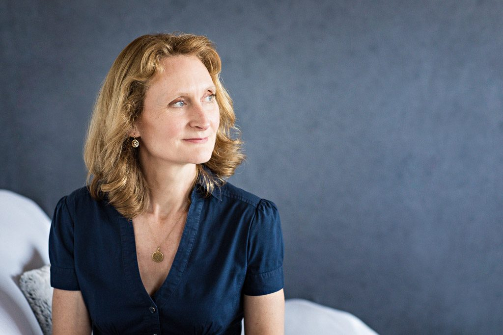 woman wears blue outfit for relaxed business portrait