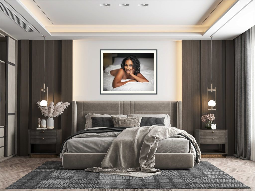 elegant framed print of a lady displayed on the bedroom wall